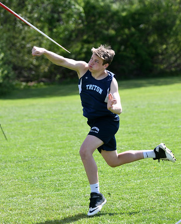 JIM VAIKNORAS/Staff photo Triton's Colon Brennanthrows the javelin in the Cape Ann League Track and Field championships at Mascomonet in Boxford Saturday.