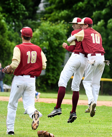 JIM VAIKNORAS/Staff photo Newburyport's Tom Murphy hugs starting pitcher Casey McClearen after the Clipper's 2-1 victory over Georgetown to win the Bert Spofford Memorial Tournament Sunday in Georgetown.