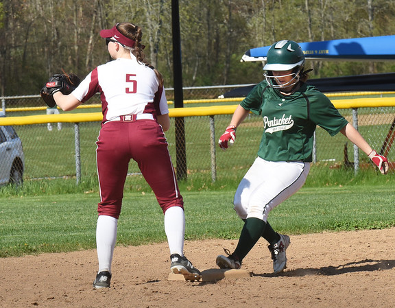 BRYAN EATON/Staff photo. Pentucket's Taylor Fitzpatrick hits a double while shortstop Meghan WInn waits for the throw.