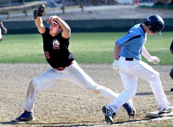 BRYAN EATON/Staff photo. Triton's Jared Beradino is called out at first.