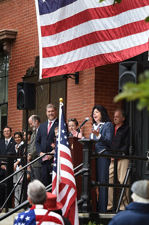 BRYAN EATON/Staff photo. Newburyport Mayor Donna Holaday recites the names of veterans who died in the past year in front of city hall.