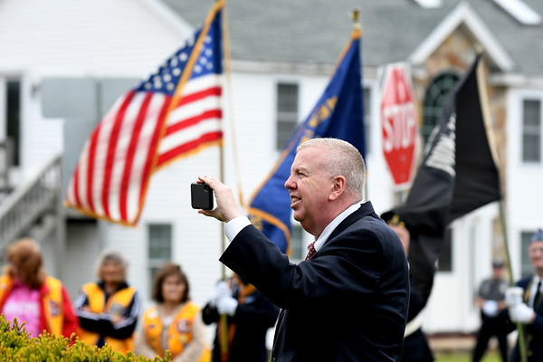 JIM VAIKNORAS/Staff photo Seabrook town manager Bill Manzi uses his photo to take video at the Memorial Day Service at town hall Sunday morning.
