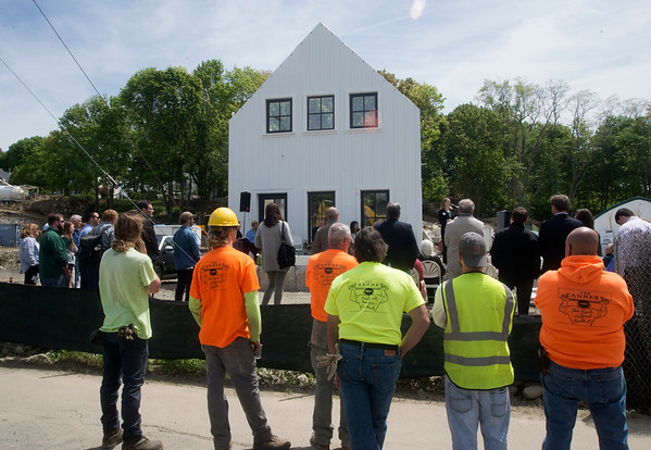 JIM VAIKNORAS/Staff photo Construction workers look on at the ground breaking of Hillside Center for Sustainable Living in Newburyport Friday.