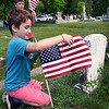 BRYAN EATON/Staff photo. Chase Tuneburg, 8, and his fellow third-graders from Amesbury Elementary School replaced American flags on the graves of the fallen in various sites in town including here at Mt. Prospect Cemetery to be ready for Memorial Day. Veteran's agent Kevin Hunt provided the flags and arranged of proper disposal of the old ones.