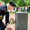 BRYAN EATON/Staff photo. Retired Army National Guard Sgt. Steve Cohen was one of several veterans who rang a bell for each veteran who died in the past year as their name was mentioned.