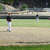 BRYAN EATON/Staff photo. Amesbury second baseman Jonathan LaVerde throws to first's Luke Lago forcing Triton's Ross Lojek out.