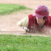 JIM VAIKNORAS/Staff photo  Newburyport's Kyle Therrien dives back to first on a pick off attempt during their game at Triton Thursday.