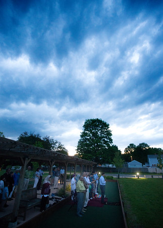 JIM VAIKNORAS/Staff photo Clouds gather at sunset, as people attending a community iftar, recite the evening prayer at the Newburyport Senior Center Wednesday night. During Ramadan, Muslims fast from sunrise to sunset, iftar is the breaking of the fast. After the prayer members of the community shared a meal on Indian food.