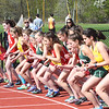 JIM VAIKNORAS/Staff photo Girls take of in the mile run at the Amesbury, Pentucket, Newburyport track meet at Bradley Fuller field in Newburyport Wednesday.