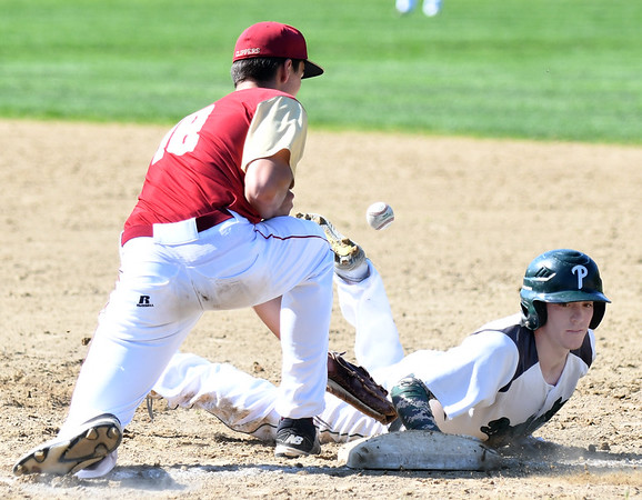 JIM VAIKNORAS/Staff photo Pentucket's Gus Flaherty dives back to first as Newburyport's  Parker McLaren waits for the throw at Pentucket Tuesday afternoon.