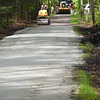 BRYAN EATON/Staff photo. Miles Bradbury of the Salisbury DPW presses down stone dust with a pavement roller on the Salisbury Ghost Trail on Wednesday morning. The department, along with The Coastal Trails Coalition, worked on some repairs and cleanup to the trail part of the events for Bay State Bike Week.