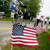 JIM VAIKNORAS/Staff photomembers of the American Legion march down Walton Road in Seabrook's annual a Memorial Day parade Sunday morning.
