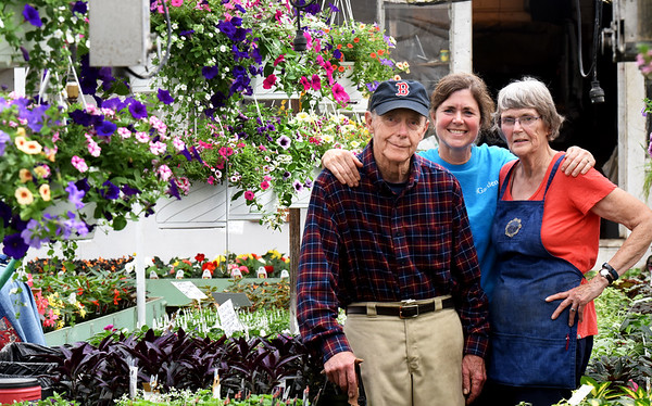 BRYAN EATON/Staff photo. Dave and Judy Marshall, with daughter Kim Mosley, center, bough Knapp's Greenhouses as a going concern in 1965. They are closing the shop with the last day being June 30.