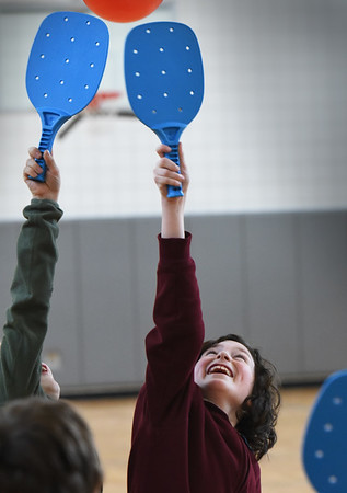 """BRYAN EATON/Staff photo. River Wynne, 10, and others in his class play ping pong with a balloon in Linda Gangemi's physical education class at Salisbury Elementary School. They were at different """"striking stations"""" working on different games like tennis, volleyball and ping pong to work on eye to hand coordination."""