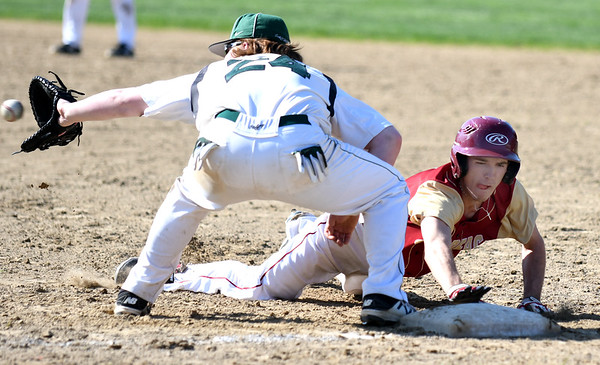 JIM VAIKNORAS/Staff photo  Newburyport's Kenny Hodge dives back to first as Pentcket'sat Pentucket Tuesday afternoon.