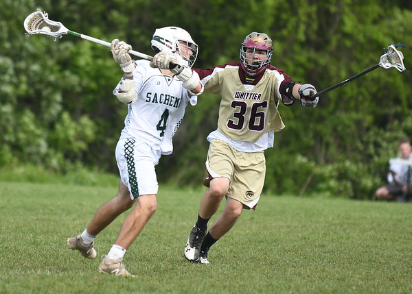 JIM VAIKNORAS/Staff photo Pentucket's Alex Satkus is guarded by Whittier's Andrew Buzzel during their game at Pipestave Hill in West Newbury Wednesday .