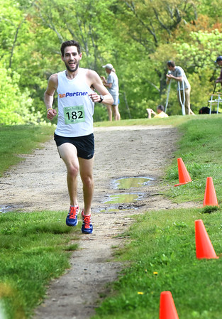 BRYAN EATON/Staff photo. Dan Chebot of Belmont approaches the finish line.
