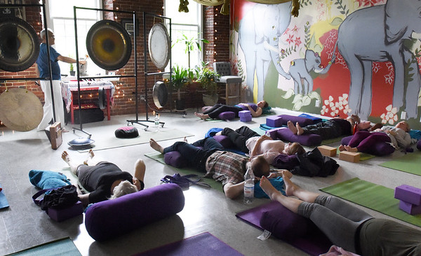 BRYAN EATON/Staff photo. Romy Valdez led this deep gong meditation class at the Rajni Center in Amesbury on Sunday afternoon.