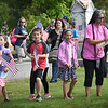 BRYAN EATON/Staff photo. Third-graders from Amesbury Elementary School, along with teachers and parent volunteers, fan out to replace flags on the graves of veteran's at Mt. Prospect Cemetery. They have been learning about soldiers starting with the American Revolution, also tied in with the history of Amesbury soldiers.