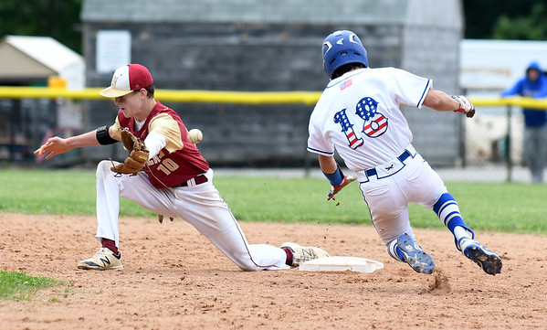 JIM VAIKNORAS/Staff photo Newburyport's Tom Murphy can't make a play as Gorgetown's Max Girouard steals second during the Clipper's 2-1 victory over Georgetown to win the Bert Spofford Memorial Tournament Sunday in Georgetown.