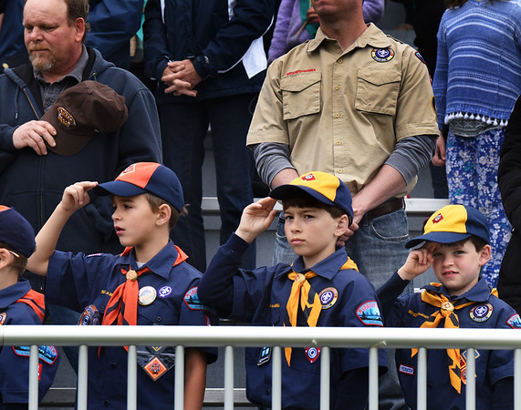 BRYAN EATON/Staff photo. Cub Scouts from Pack 4 in Amesbury salute during the playing of the National Anthem.