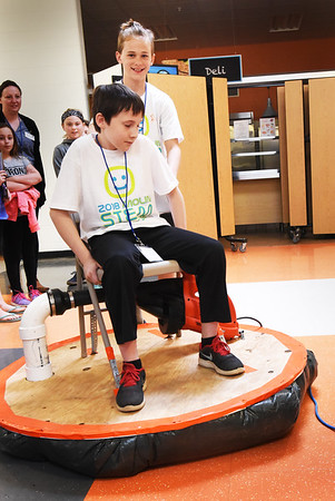 BRYAN EATON/Staff photo. Drew Hull, sitting, and Merrick Barlow, both 11, were a hit of the STEM Showcase with their Leaf Blower Hovercraft.