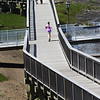 BRYAN EATON/Staff photo. Walkers and joggers came and went along the Clipper City Rail Trail on Wednesday afternoon taking in the nice weather. The nice weather continues into the Memorial Day Weekend, though showers are possible.