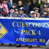 BRYAN EATON/Staff photo. Cub Scout Pack 4 marches along Main Street in Amesbury.