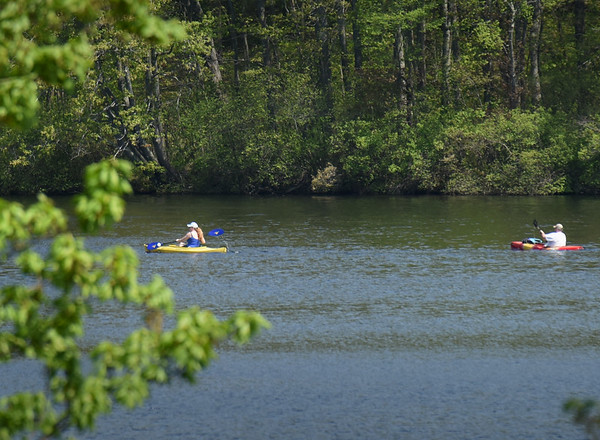BRYAN EATON/Staff photo. Kayakers paddle along Lake Gardner in Amesbury framed by emerging leaves late Tuesday morning. The rest of the week is a mixed bag weatherwise with some rain in the forecast with temperatures varying.