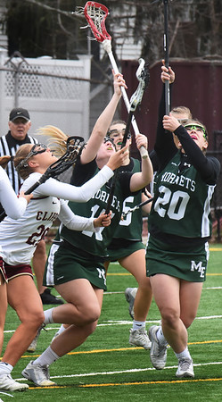 BRYAN EATON/Staff photo. Newburyport's Maggie Pons goes for a loose ball along with Maggy Delisio and Christina Calqudia.