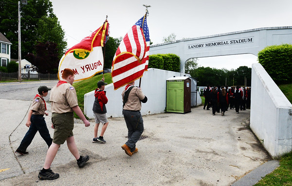 BRYAN EATON/Staff photo. The Boy Scouts and other Amesbury parade participants head into Landry Memorial Stadium for services.