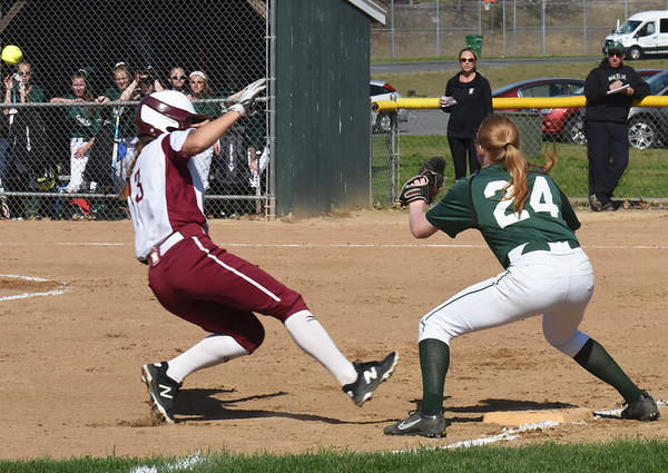 BRYAN EATON/Staff photo. Newburyport's Olivia Salvatore makes it third as Pentucket's Autumn West waits for the throw.