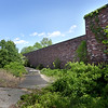 BRYAN EATON/Staff photo. The former MicroFab manufacturing facility is barely noticeable to motorists on Haverhill Road in Amesbury.