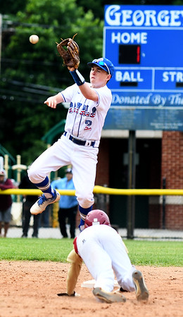JIM VAIKNORAS/Staff photo Newburyport's Tyler Koglin steals second as Georgetown's Colin Nally goes up to field the throw during the Clipper's 2-1 victory over Georgetown to win the Bert Spofford Memorial Tournament Sunday in Georgetown.