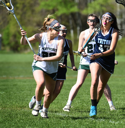 BRYAN EATON/Staff photo. Pentucket's Clara Dore moves the ball past Triton defender Kennedy.