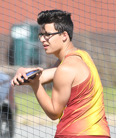 JIM VAIKNORAS/Staff photo Newburyport's Nate Armano with the discus at the Cape Ann League Track and Field championships at Mascomonet in Boxford Saturday.