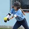 JIM VAIKNORAS/Staff photo Triton's Taylor Penniman lays down one of 2 bunt singles against Newburyport at Triton Wednesday.