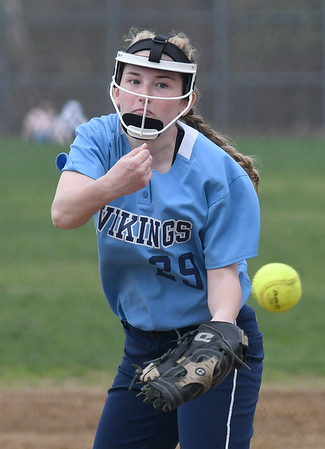 JIM VAIKNORAS/Staff photo triton pitcher Katherine Quigley against Amesbury  at Perry Field in Amesbury Friday.