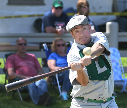 JIM VAIKNORAS/Staff photo Lee Smith of the . Lynn Live Oaks keeps his eye on the ball as he gets a hit against  the Portsmouth Rockinghams at the Spencer-Peirce-Little farm in Newbury Saturday.