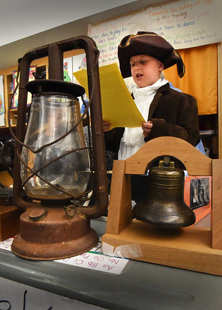 BRYAN EATON/Staff photo. Carter Whitney, 8, presents the life of American Revolution hero Paul Revere. The patriot, who was born in Boston in 1735, died in 1818 and was one of the people warning about the British coming to take the colonists black powder supply.