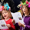 "BRYAN EATON/Staff photo. Josie Wizda, left, and Saskia Howe, both 6, sing ""This Land is Your Land"" at Brown Square in Newburyport on Tuesday morning. The Woody Guthrie song was one of several the Newburyport Montessori School students sang, this year with elderly residents of Avita attending as guests."
