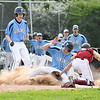 JIM VAIKNORAS/Staff photo Triton's Dylan Shute slides safely into home under the tag of Newburyport catcher Ken Hodge during their game at Triton Thursday.