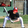 BRYAN EATON/Staff photo. Amesbury's Jonathan LaVerde avoids an errant ball.
