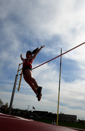 JIM VAIKNORAS/Staff photo Amesbury's Beverly Browne throws her hands up in celebration after clearing the height in the pole vault at the Pentucket, Amesbury, Newburyport meet at Fuller Field Wednesday.