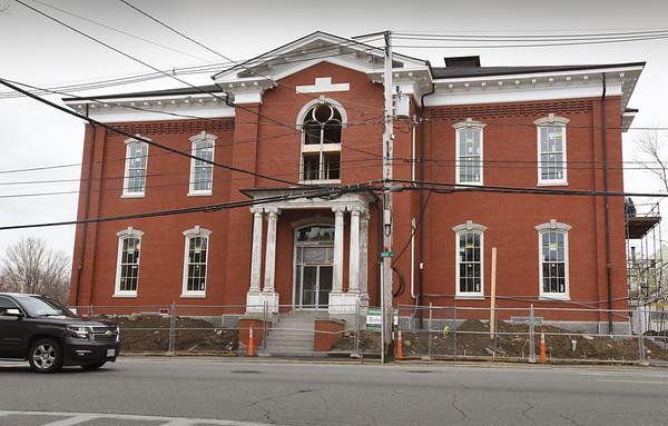 BRYAN EATON/Staff photo. Newburyport's old Kelley School is being converted into luxury condos.