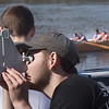 BRYAN EATON/Staff photo. Senior Adam Woodsom learns the basics of using a sextant which will help in triangulation as they row to certain points on the river.