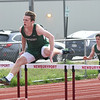 JIM VAIKNORAS/Staff photo Pentucket's Jack Clohisy in the high hurdles at the Pentucket, Amesbury, Newburyport meet at Fuller Field Wednesday.