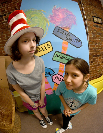 JIM VAIKNORAS/Staff photo Hannah Balaam, 14,  as the Cat in the Hat and Samantha Evans, 8, as JoJo in the Amesbury Community Theatre's production of Seussical the Musical.