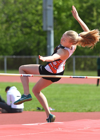 JIM VAIKNORAS/Staff photo Ipswich's Annika Brinks in the high jump at the Cape Ann League Track and Field championships at Mascomonet in Boxford Saturday.