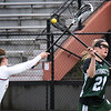 BRYAN EATON/Staff photo. Clipper's Margaret Cote tries to knock the ball from Manchester-Essex player Drew Charlton.
